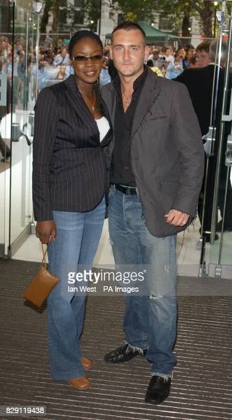 Actor Will Mellor and his partner arrives for the UK premiere of I Robot at the Odeon Leicester Square in central London
