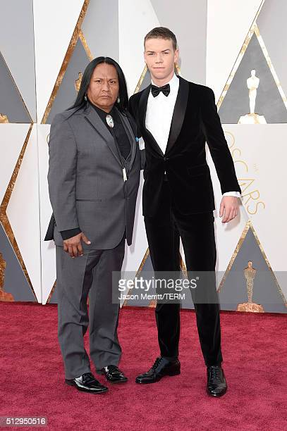 Actor Will Poulter and Arthur RedCloud attend the 88th Annual Academy Awards at Hollywood Highland Center on February 28 2016 in Hollywood California