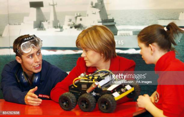 Actor Will Roberts Deputy First Minister Nicola Sturgeon and student Jennifer Fraser look at a fake UAV during the launch of the Scottish leg of the...