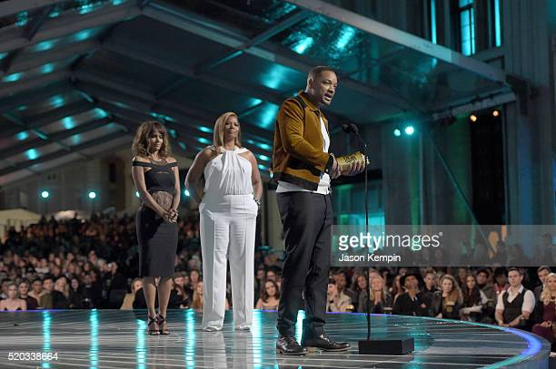 Actor Will Smith accepts the MTV Generation award from actresses Halle Berry and Queen Latifah onstage during the 2016 MTV Movie Awards at Warner...