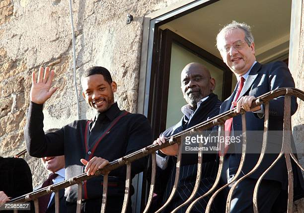 US actor Will Smith admires the Roman Forum from the Rome's City Hall balcony with Italian director Gabriele Muccino Chris Gardner and Rome's Mayor...