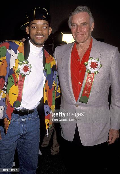 Actor Will Smith and actor Charlton Heston attend the 60th Annual Hollywood Christmas Parade on December 1 1991 at KTLA Studios in Hollywood...