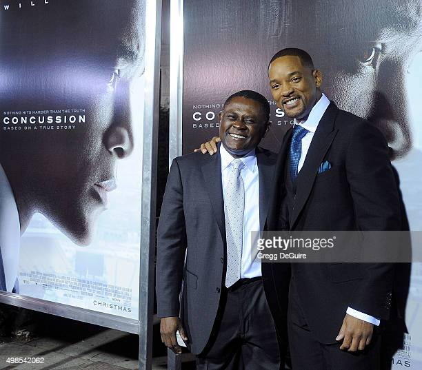 Actor Will Smith and Dr Bennet Omalu arrive at the screening of Columbia Pictures' Concussion at Regency Village Theatre on November 23 2015 in...