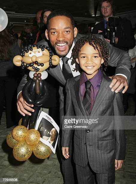 Actor Will Smith and his son Jaden pose with a balloon model resembling Smith senior created by Prince's Trust beneficiary Jo Uddin at a charity...