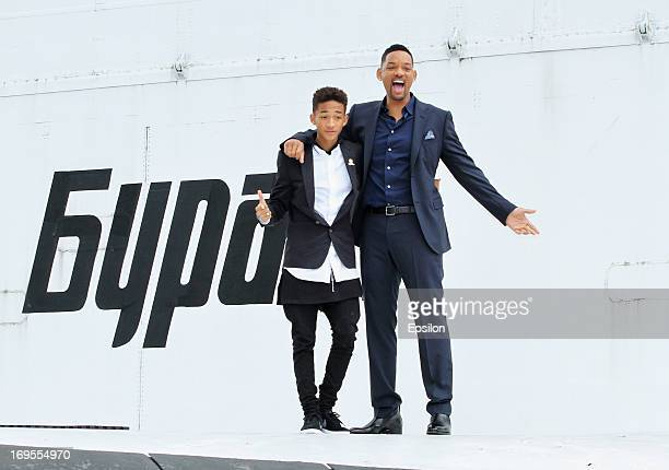 Actor Will Smith and his son Jaden Smith pose on the wing of Russian spacecraft Buran during the After Earth Photocall in Gorky park on May 27 2013...