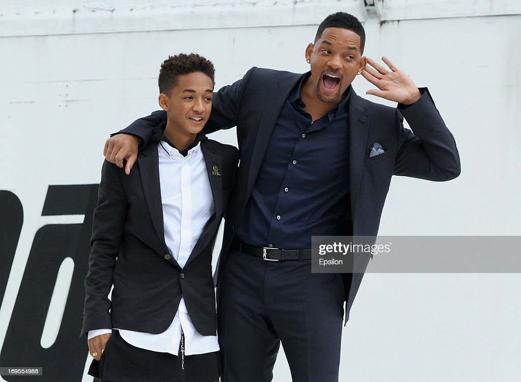 Actor Will Smith and his son Jaden Smith pose on the wing of Russian spacecraft Buran during the After Earth - Photocall in Gorky park on May 27, 2013 in Moscow, Russia.
