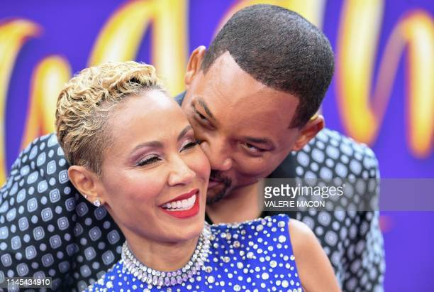 TOPSHOT US actor Will Smith and his wife actress Jada Pinkett Smith attend the World Premiere of Disneys Aladdin at El Capitan theatre on May 21 2019...