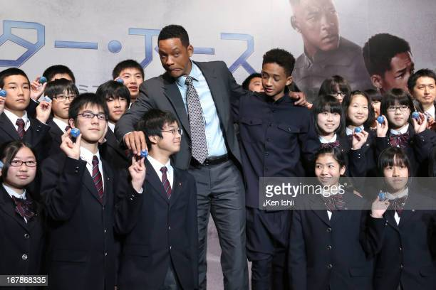 Actor Will Smith and Jaden Smith pose for photo with junior high school students during the 'After Earth' Press Conference at the Ritz Carlton Tokyo...