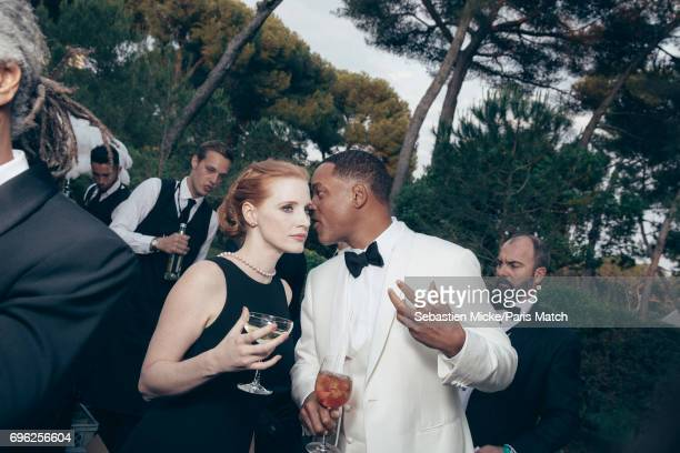 Actor Will Smith and Jessica Chastain wearing a Prada dress are photographed for Paris Match whilst attending the Amfar Gala at the Eden Roc Hotel on...