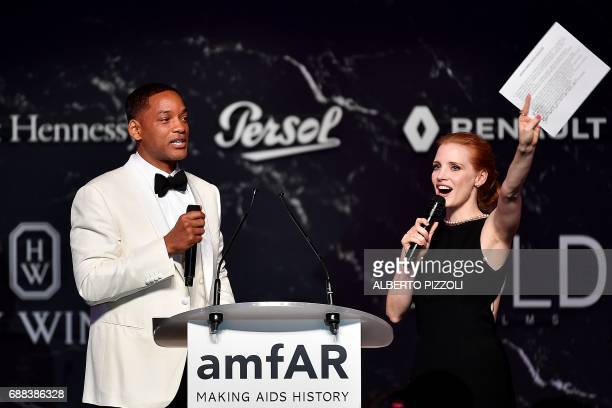 US actor Will Smith and US actress Jessica Chastain conduct an auction during the amfAR's 24th Cinema Against AIDS Gala on May 25 2017 at the Hotel...