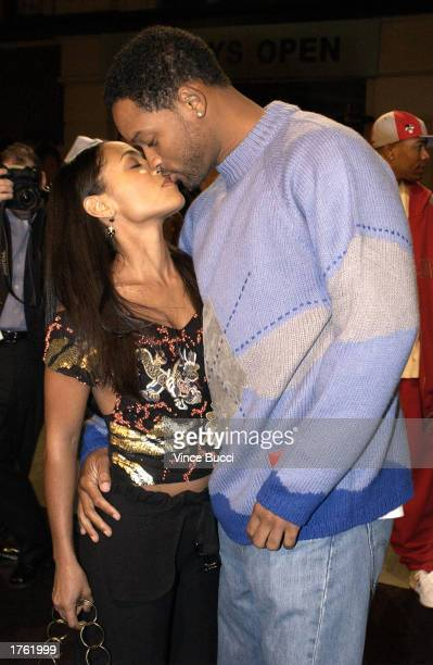 Actor Will Smith and wife actress Jada Pinkett Smith kiss at the screening of the short animated film 'Final Flight of the Osiris' and the debut of...