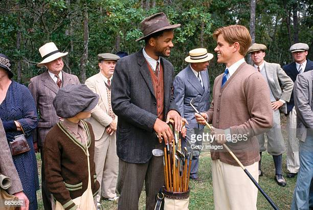 Actor Will Smith as Bagger Vance and Matt Damon as Rannulph Junuh right take heart as Junuh's game steadily improves in Robert Redford's The Legend...