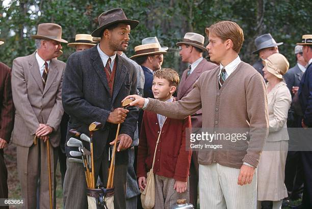 Actor Will Smith as Bagger Vance and Matt Damon as Rannulph Junuh right decide their next move with the help of young protege Hardy played by J...