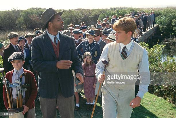 Actor Will Smith as Bagger Vance dispenses advice to Matt Damon as Rannulph Junuh right with the help of his young protege Hardy played by J Michael...