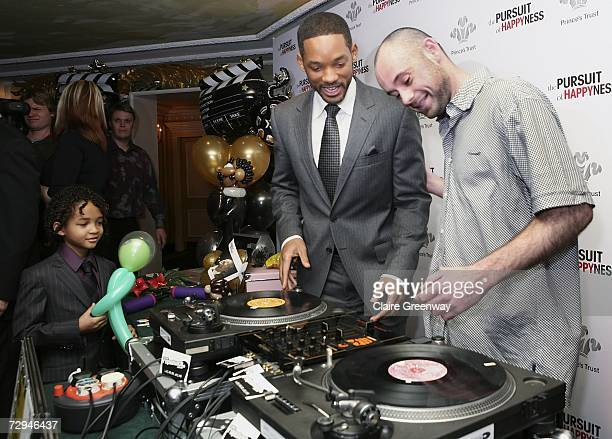 Actor Will Smith demonstrates his DJing skills with Prince's Trust beneficiary 'Area 51' DJ Adam Gibbs watched by Smith's son Jaden at a charity...