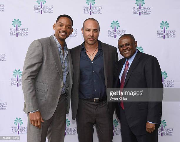 Actor Will Smith director Peter Landesman and Dr Bennet Omalu attend a screening of Concussion at the 27th Annual Palm Springs International Film...
