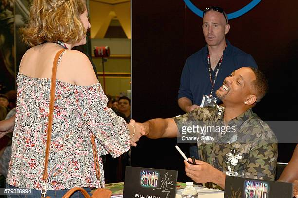 Actor Will Smith from the cast of Suicide Squad film participates in an autograph session for fans in DC's 2016 ComicCon booth at San Diego...
