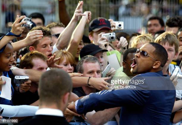 US actor Will Smith greets fans at the premiere of his new film IRobot an action film about robots turning against the human race at the Odeon Cinema...