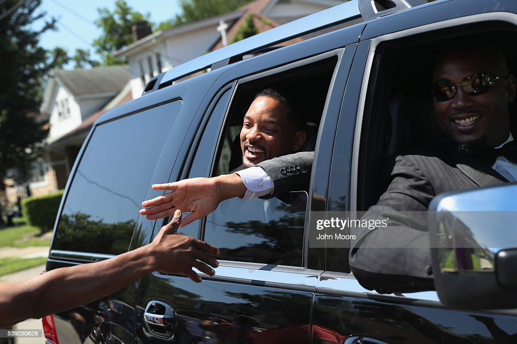 Actor Will Smith greets the public while riding in the funeral procession of Muhammed Ali on June 10, 2016 in Louisville, Kentucky. Smith played the boxing legend in the film 'Ali' in 2001 and was a pall-bearer at Ali's funeral. The funeral possession winded through Louisville, preceding a memorial service and giving the public an opportunity to honor the four-time world heavyweight boxing champion, who died on June 3 at age 74,