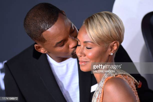 TOPSHOT US actor Will Smith kisses actress Jada Pinkett Smith as they arrive for the premiere of Gemini Man at the TCL Chinese Theatre in Hollywood...