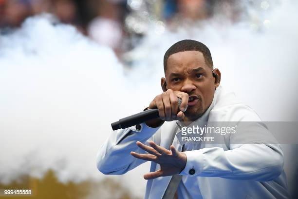 TOPSHOT US actor Will Smith performs during the closing ceremony of the Russia 2018 World Cup ahead of the final football match between France and...
