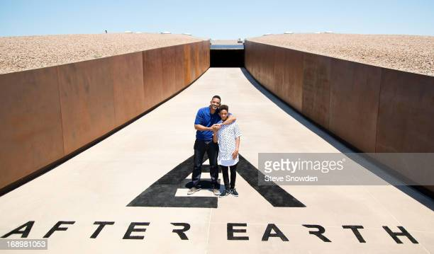 """Actor Will Smith poses with his son and co-star Jaden Smith outside the main entrance of Spaceport America during Colombia Pictures' """"After Earth""""..."""