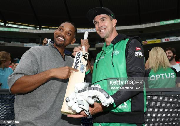 Actor Will Smith poses with Kevin Pietersen of the Stars prior to the Big Bash League match between the Melbourne Stars and the Sydney Thunder at...