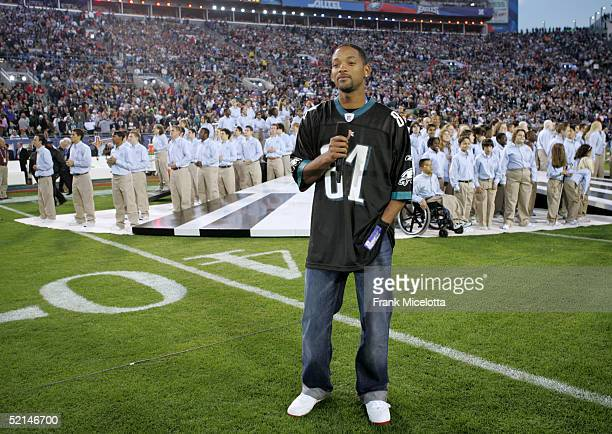 Actor Will Smith presents Alicia Keys during the XXXIX Superbowl pregame show at Alltel Stadium on February 6 2005 in Jacksonville Florida