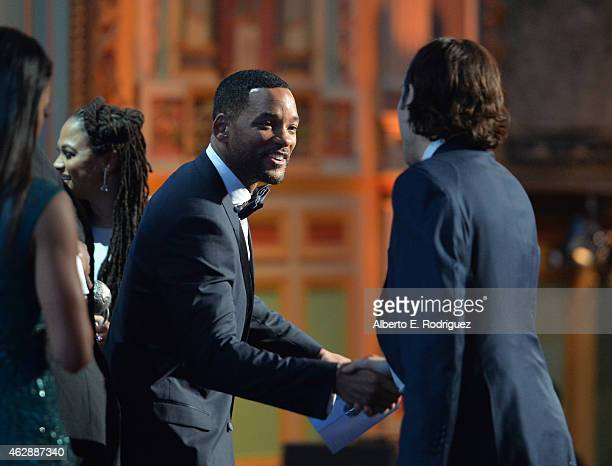 Actor Will Smith presents the Outstanding Motion Picture award for 'Selma' onstage to director/producer Ava DuVernay and producer Jeremy Kleiner...