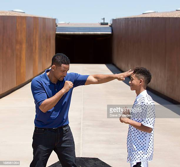 """Actor Will Smith pretends to spar with his son and co-star Jaden Smith during Colombia Pictures' """"After Earth"""" Press Junket at Spaceport America on..."""