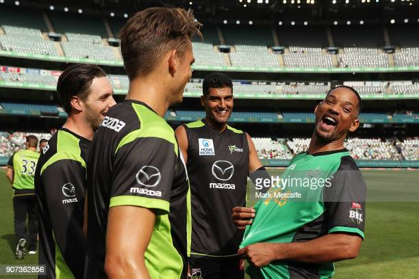 Actor Will Smith shares a laugh with Thunder players before the Big Bash League match between the Melbourne Stars and the Sydney Thunder at Melbourne...