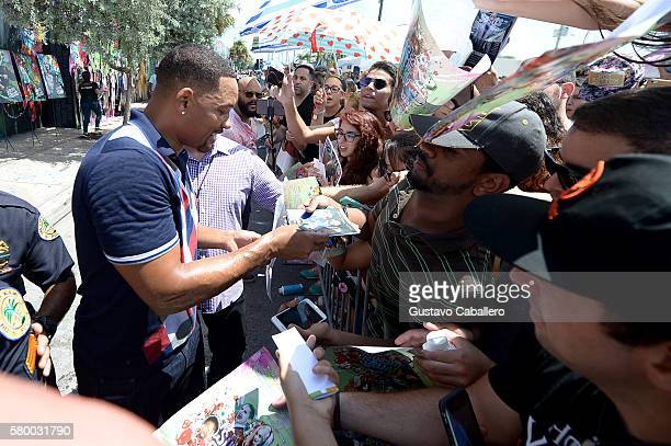 Actor Will Smith signs autographs for fans at the 'Suicide Squad' Wynwood Block Party and Mural Reveal on July 25 2016 in Miami Florida