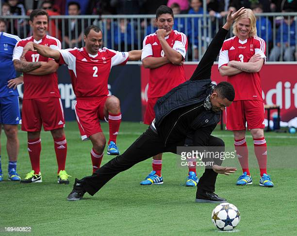 US actor Will Smith strikes a pose as he visits the UEFA Champions Festival in east London on May 25 2013 to kick off the Ultimate Champions match...