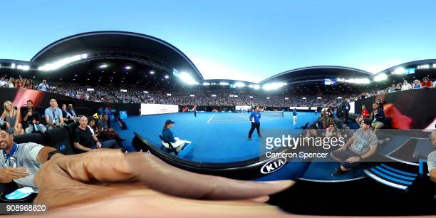 Actor Will Smith takes a photo with a 360 degree camera during the third round match between Nick Kyrgios of Australia and JoWilfried Tsonga of...