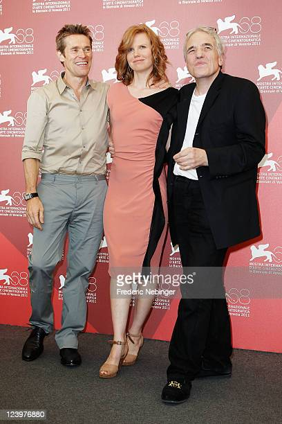 Actor Willem Dafoe actress Shanyn Leigh and director Abel Ferrara pose at the 444 Last Day On Earth photocall during the 68th Venice Film Festival at...