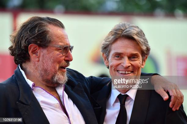 Actor Willem Dafoe and director Julian Schnabel arrive to attend the awards ceremony of the 75th Venice Film Festival on September 8 2018 at Venice...