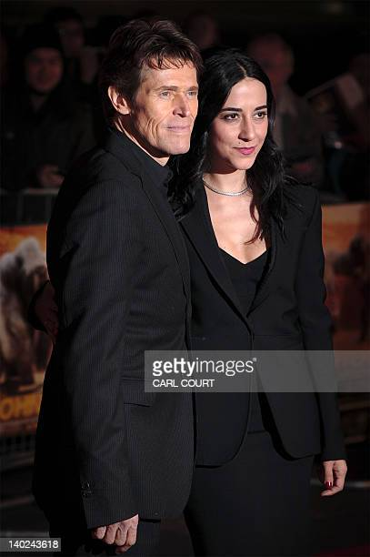 US actor Willem Dafoe and his wife Giada Colagrande attend the UK premiere of John Carter in central London on March 01 2012 AFP PHOTO/CARL COURT