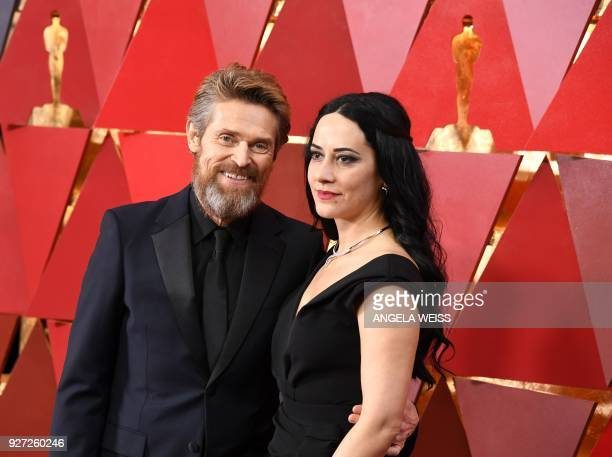 US actor Willem Dafoe and his wife Italian director Giada Colagrande arrive for the 90th Annual Academy Awards on March 4 in Hollywood California /...