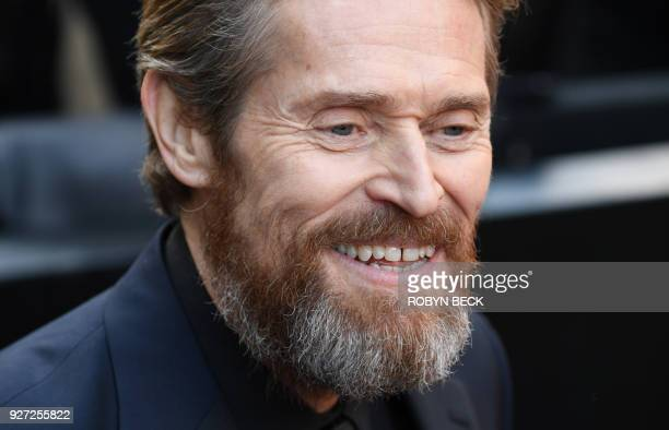 US actor Willem Dafoe arrives for the 90th Annual Academy Awards on March 4 in Hollywood California / AFP PHOTO / Robyn Beck