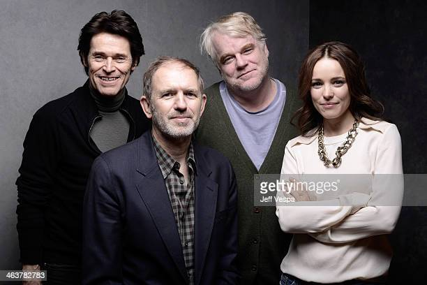 Actor Willem Dafoe director Anton Corbijn and actors Philip Seymour Hoffman and Rachel McAdams pose for a portrait during the 2014 Sundance Film...