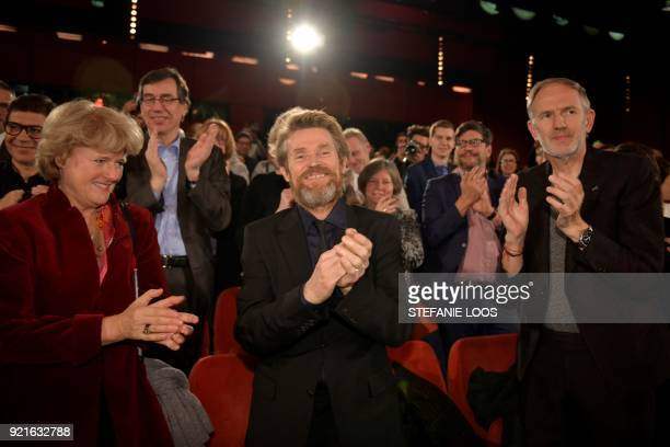 US actor Willem Dafoe is applauded by German State Secretary for Culture and the Media Monika Gruetters and Netherlands' photographer Anton Corbijn...