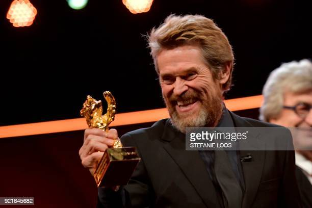 US actor Willem Dafoe poses after he received the Honorary Golden Bear award during a ceremony on February 20 2018 during the 68th edition of the...