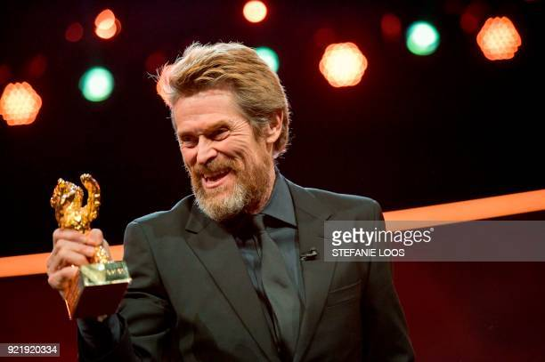 TOPSHOT US actor Willem Dafoe poses after he received the Honorary Golden Bear award during a ceremony on February 20 2018 during the 68th edition of...