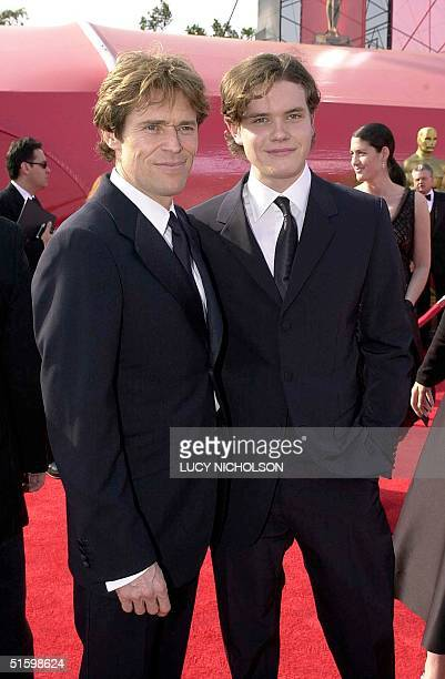 Actor Willem Dafoe poses with his son Jack as they arrive at the Shrine Auditorium during the 73rd Academy Awards in Los Angeles, California, 25...
