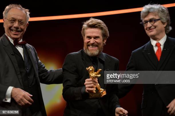 US actor Willem Dafoe receives from Berlinale Director Dieter Kosslick the Honorary Golden Bear award as US director Wim Wenders looks on during a...