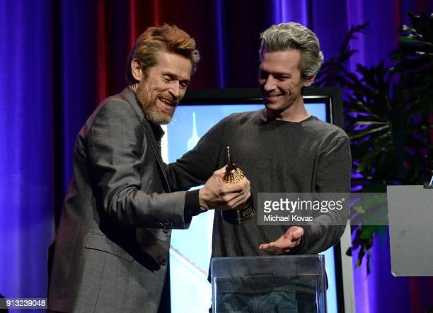 Actor Willem Dafoe receives the Cinema Vanguard Award from director Josh Boone at The Santa Barbara International Film Festival on February 1 2018 in...