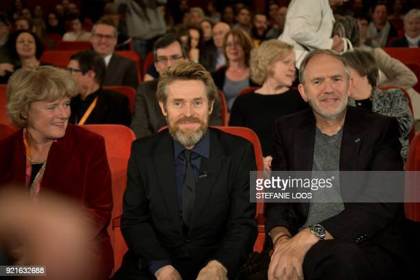 US actor Willem Dafoe sits next to German State Secretary for Culture and the Media Monika Gruetters and Dutch photographer Anton Corbijn during a...