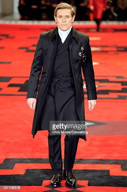 Actor Willem Dafoe walks the runway at the Prada Autumn Winter 2012 fashion show during Milan Menswear Fashion Week on January 15, 2012 in Milan,...