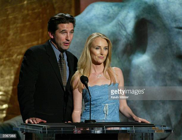 Actor William Baldwin and wife Chynna PhillipsBaldwin speak on stage during the 17th Annual Genesis Awards at the Beverly Hilton Hotel on March 15...
