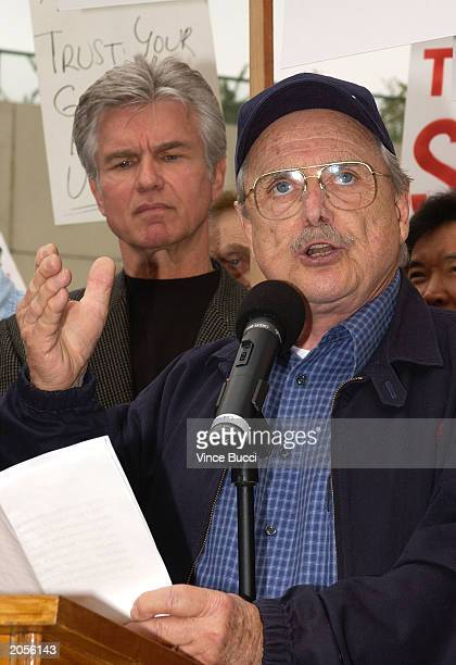 Actor William Daniels speaks as actor Kent McCord looks on at a rally against a proposed merger between the Screen Actors Guild and the American...